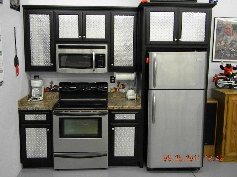 The diamond plate inserts give this a small run of cabinets in a garage, a tough, manly look!