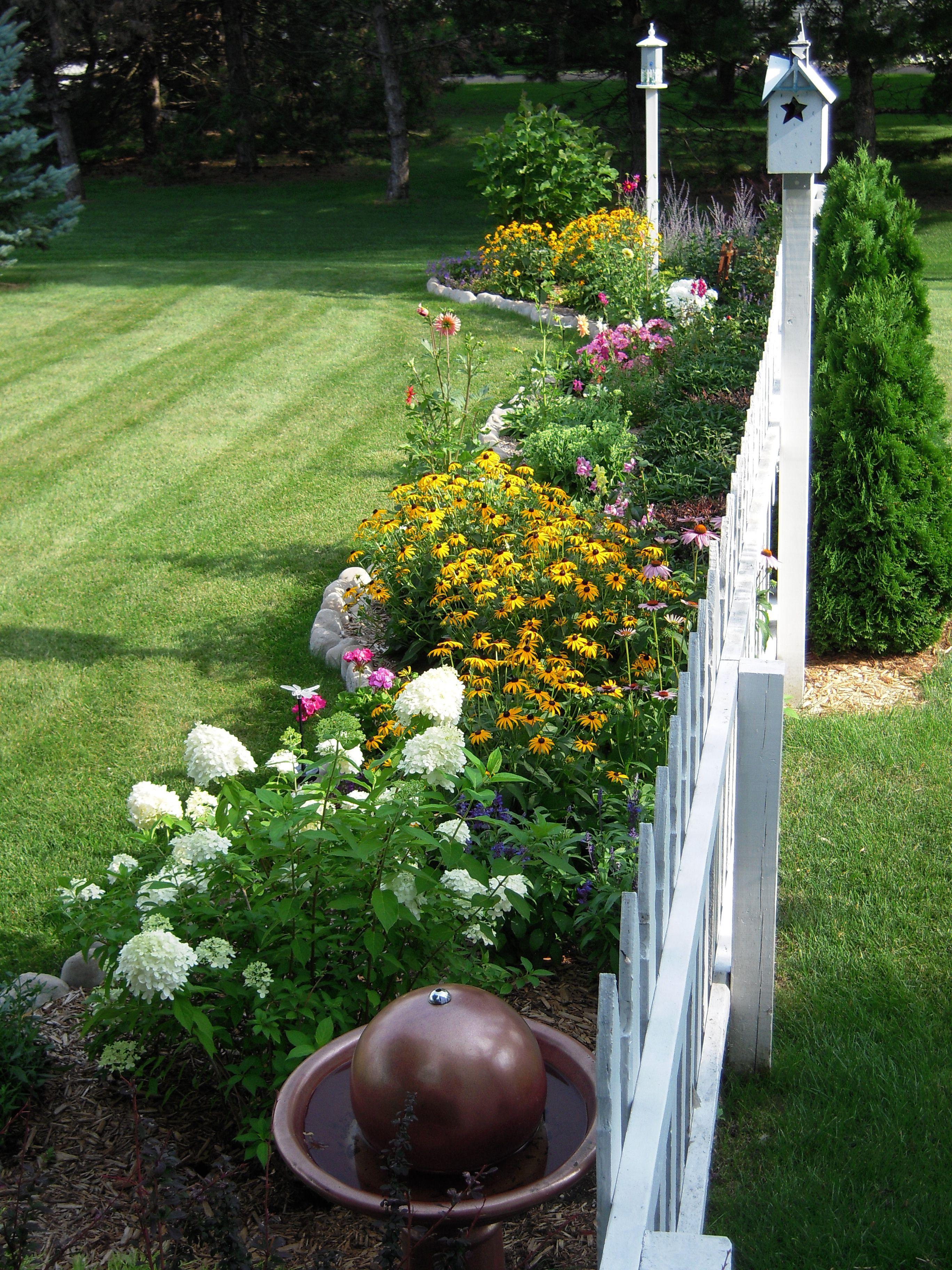 White picket fence flowers bird housesa few