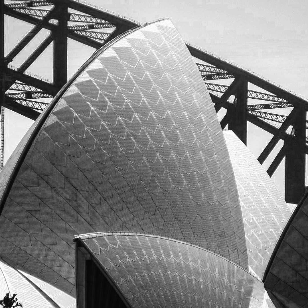 I like this close-up of the sails on the Sydney Opera House with the Sydney Harbour Bridge behind.  #sydney #sydneyoperahouse #sydneyharbourbridge #sydneyharbour #australia #blackandwhitephoto #travel #travelphoto #oz 8.2008 by skiddleybump http://ift.tt/1NRMbNv