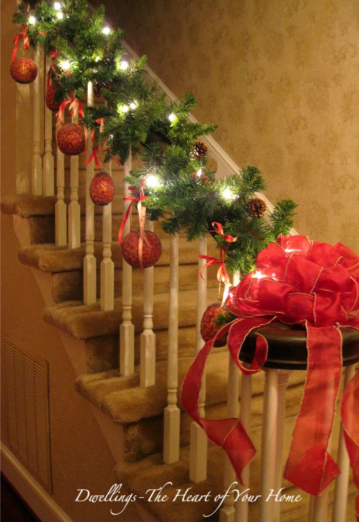 decorating banister for christmas the banister is decorated with garland lights ribbon and some - Decorating Banisters For Christmas With Ribbon