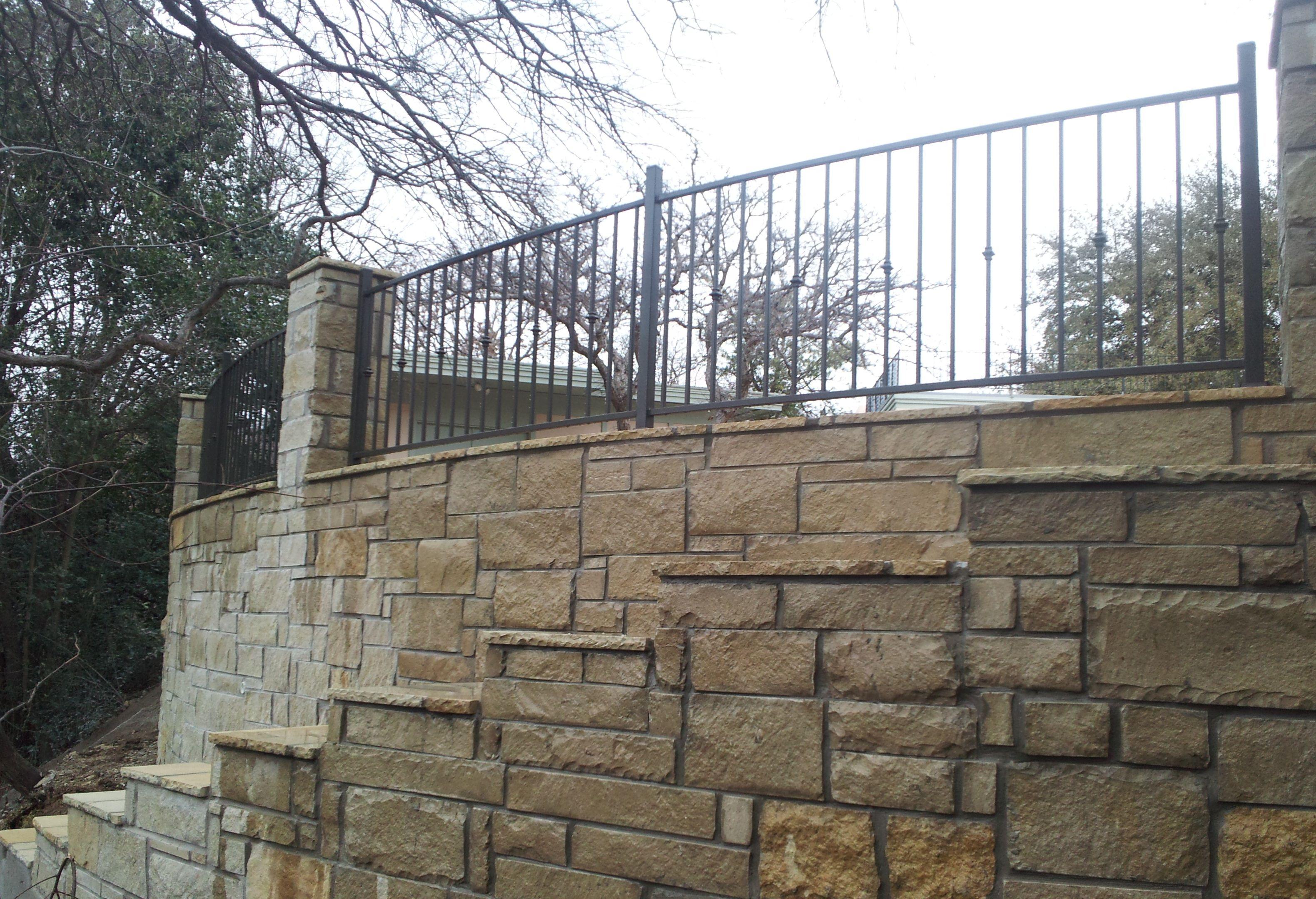 Reinforced Concrete Retaining Wall With Antique Leuder Stone Veneer Patio Stones Hardscape Concrete Retaining Walls