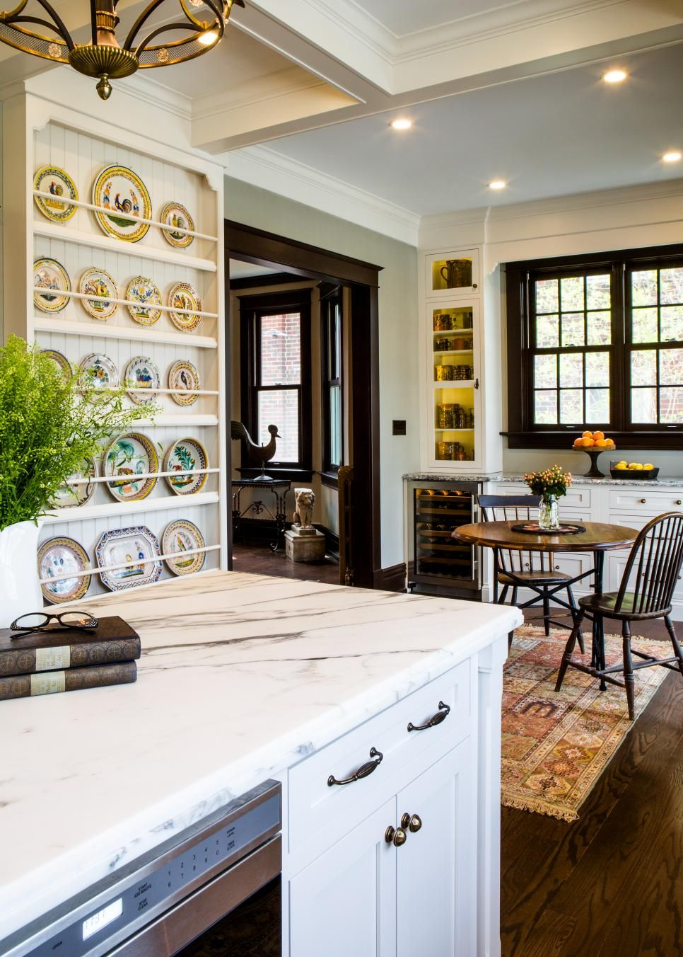 Awesome Two Different Shaped Chairs Sit At A Simple, Round Wooden Dining Table. A  Built In Shelf Structure Displays An Elegant Plate ... Amazing Ideas