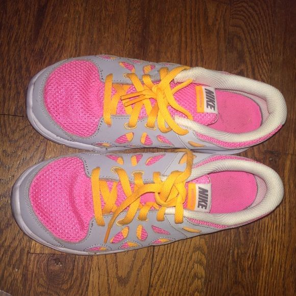Nike Girl Sneakers! White,gray,pink and orange sneakers for girls. Size 3, Gently used, need to get rid of. These shoes are light! I absolutely love them. Willing to trade, offers accepted. Nike Shoes Sneakers