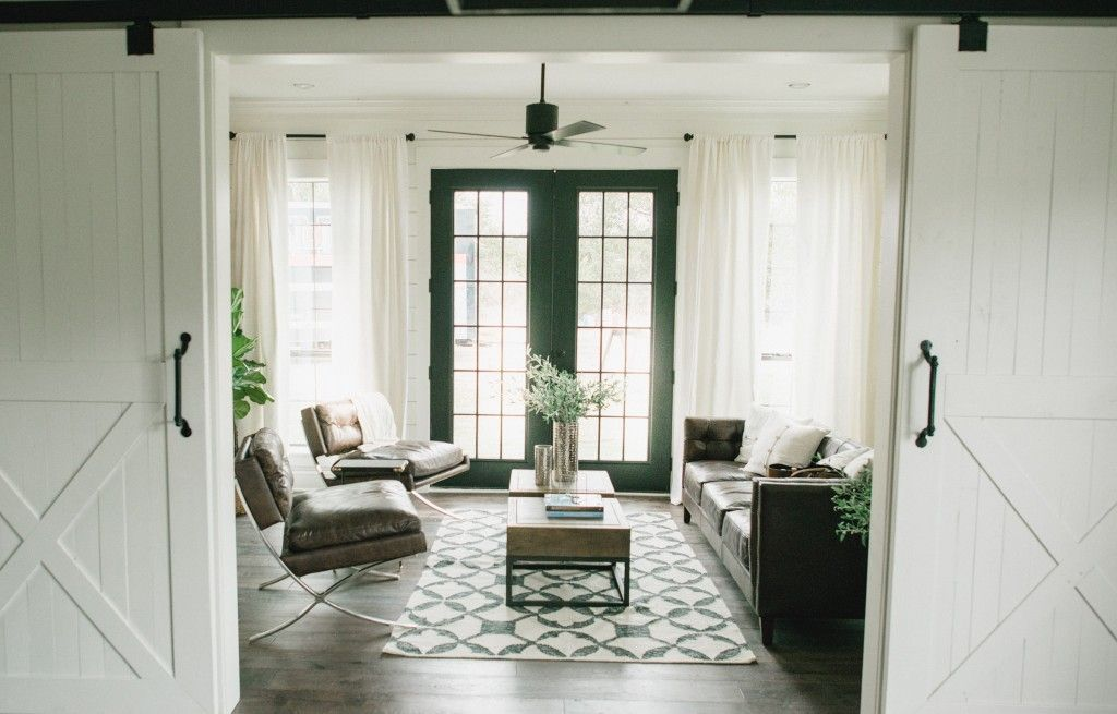 clean modern decor meets country rustic in living space for barndominum i fixerupper
