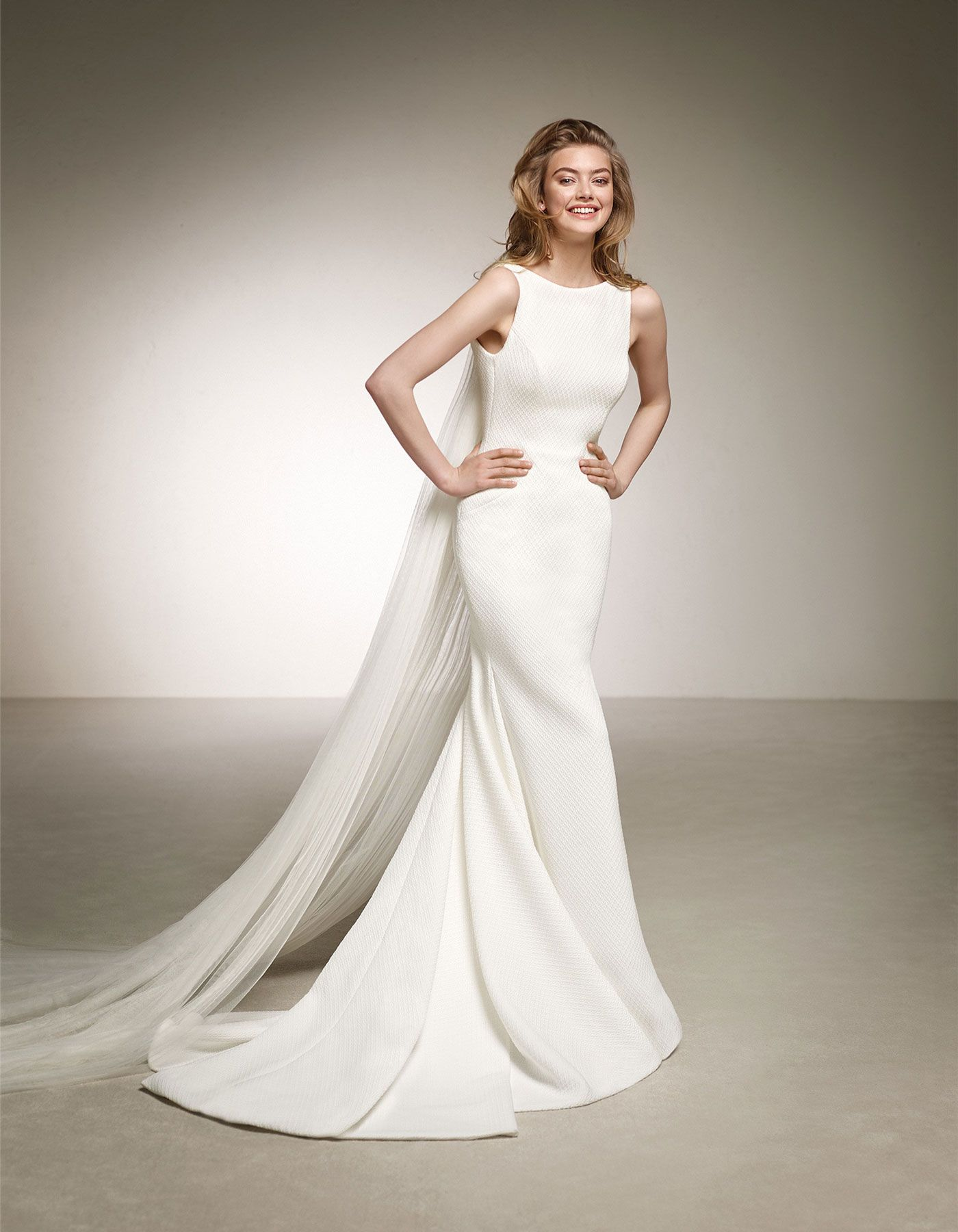 Debles by Pronovias The simplicity and classic lines of this brocade ...