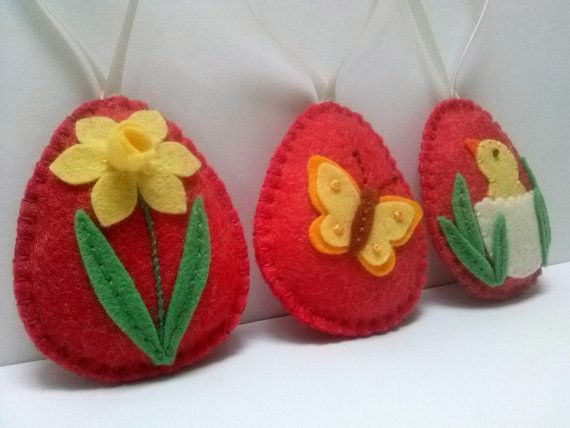 Felt easter decoration - red felt eggs yellow decorated- flower, butterfly and chicken / set of 3  Listing is for 3 ornaments  If you would like just one of the eggs or different combination, please convo me and I will prepare variation for you.  Size of my decorated eggs is about 2 1/8 x 2 5/8 inch (5,3 x 6,5 cm) This is size of felt egg without hanging loop  Handmade from wool blend and wool felt