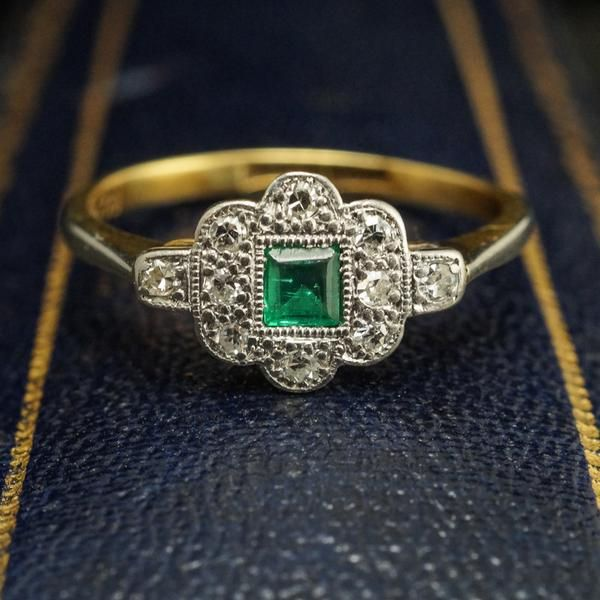 This immaculate early Deco ring features a verdant .14ct emerald set…