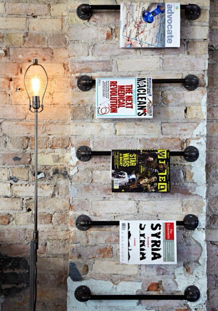 Porte revue ikea en fer noir pour les murs mur de briques for Porte revue ikea