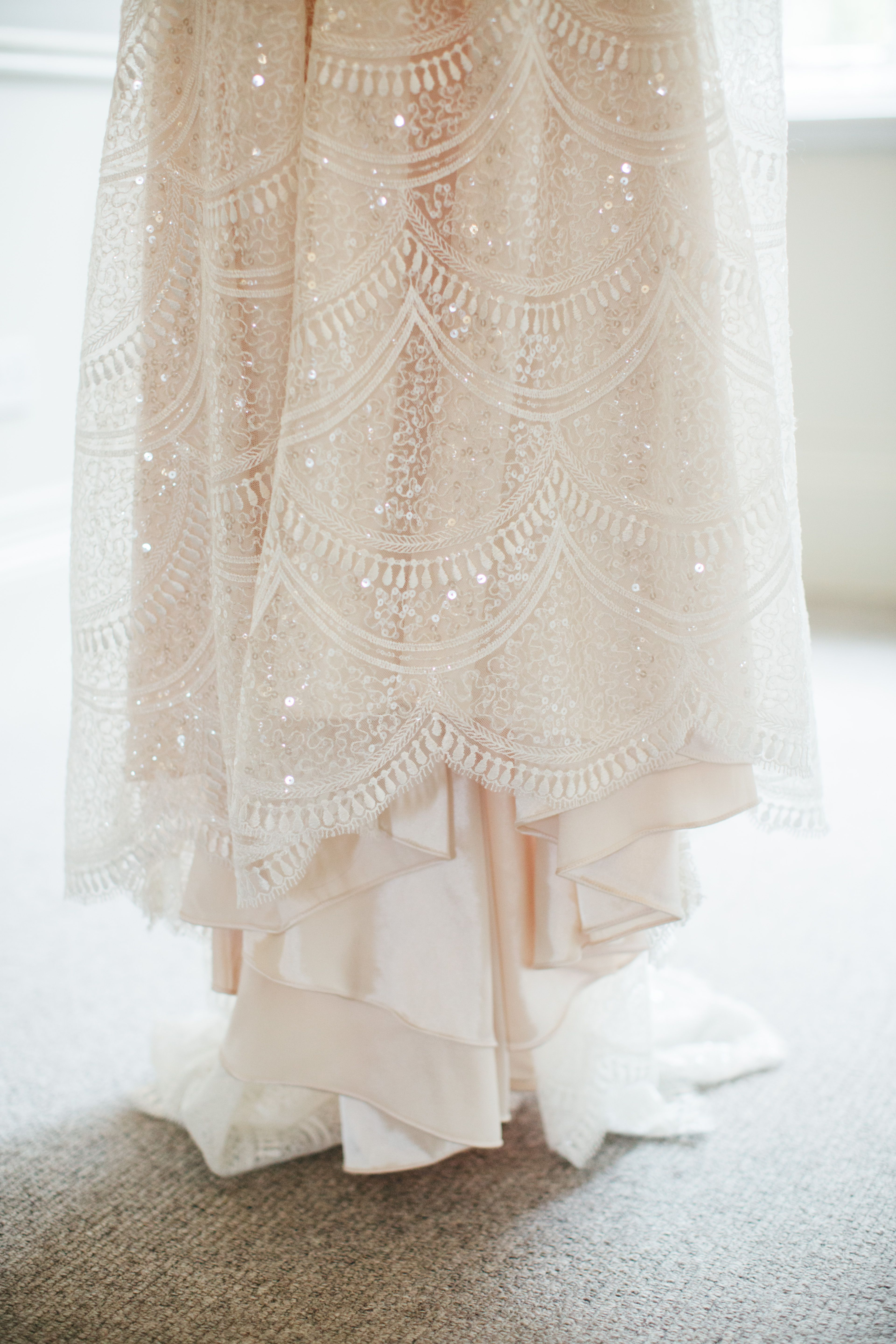 WEDDING PHOTOGRAPHY Hanging blush white wedding dress with lace and ...