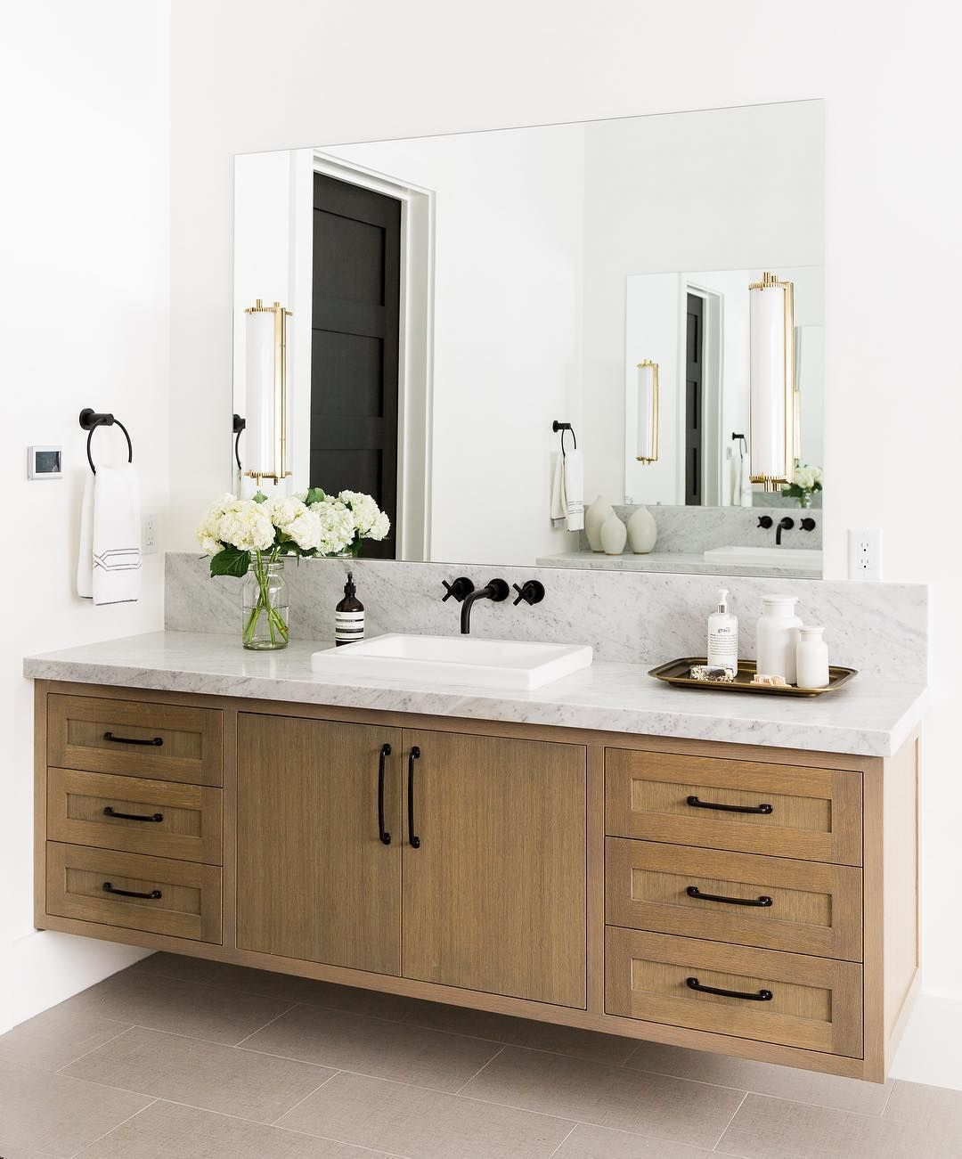 Bathroom Sconces Above Mirror brass sconces over plate mirror stained wood vanity black matte