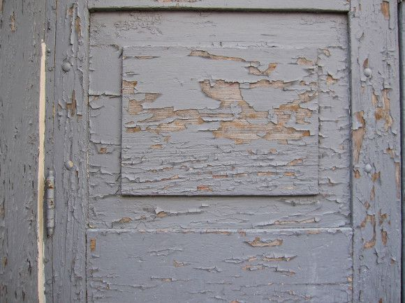 Peeling paint on old wooden door, have them inspected for lead base paint for child safety