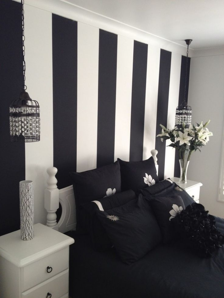 Inspiring painted wall designs for bed room by black white stripped wall feat black bedsheet between white picket drawers and hanging lamps of shocking