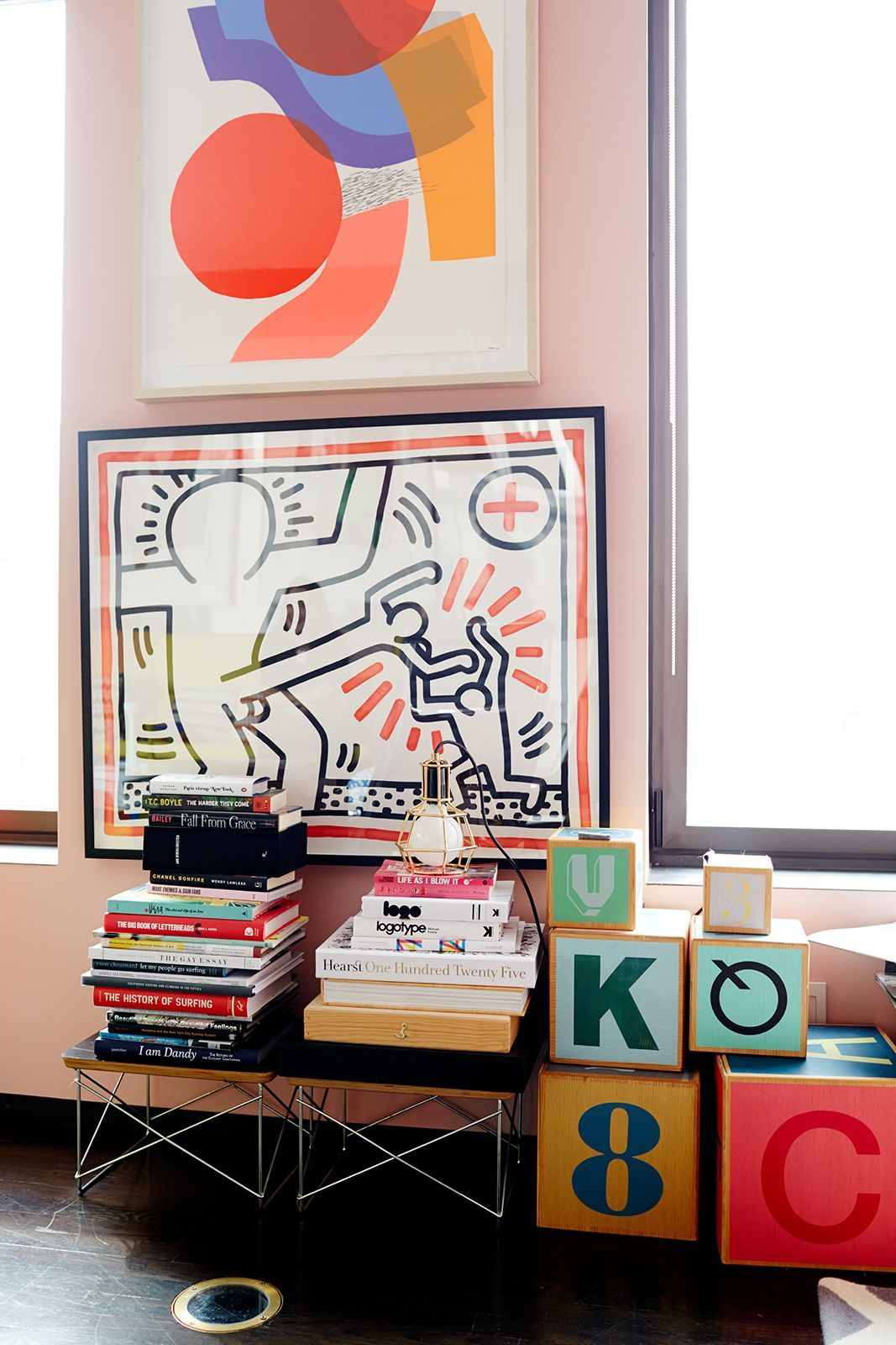 Meet The CEO Who Mixes Bold Colors Like A Boss #refinery29  http://www.refinery29.com/bradford-shellhammer-home-tour#slide-8  Artworks hung closely together and low to the ground may seem taboo, but totally work in Shellhammer's no-holds-barred apartment. A modern piece by Hense sits atop a prized Keith Haring. Large child blocks complete the great mix of high and low.