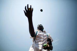 A displaced child juggles fruit at the child-friendly space run by the humanitarian organisation Terre des Hommes, with the support of Unicef, in Juba, South Sudan