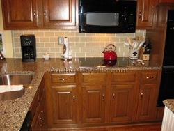 Simple Glass Backsplash That Complements Busy Countertop Kitchen