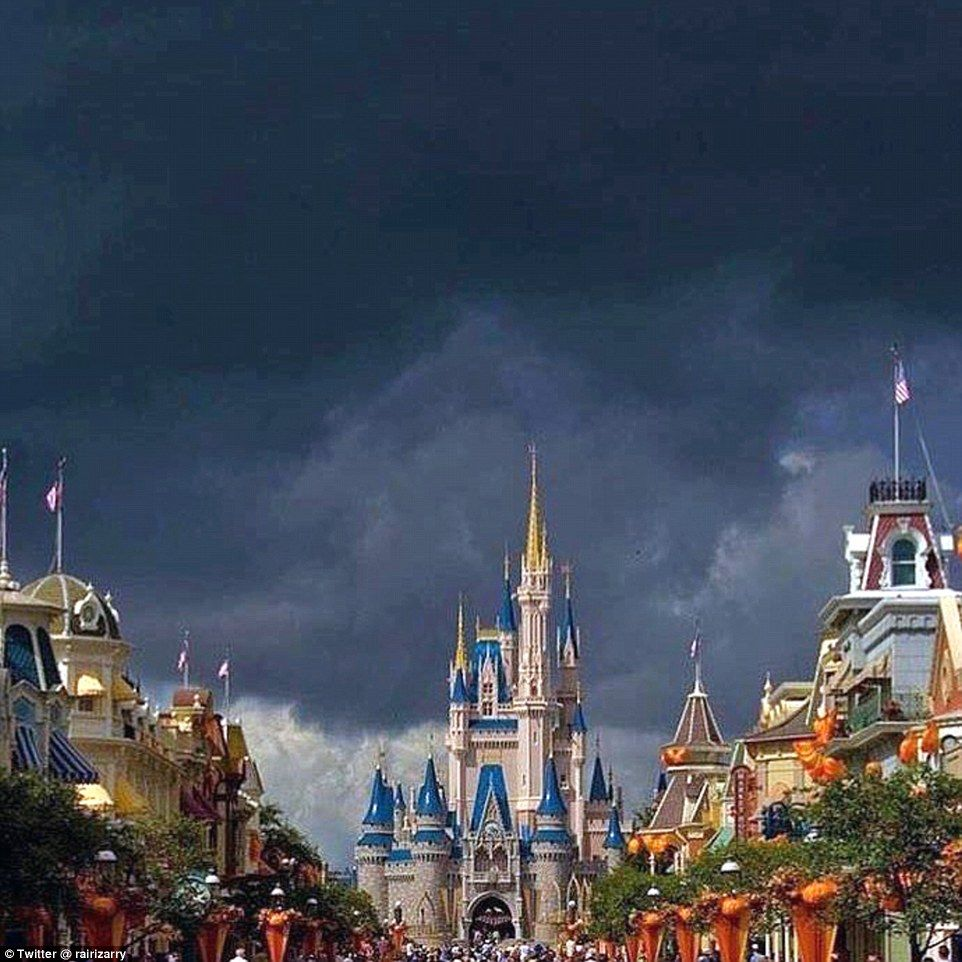 Powerful: Dark clouds were pictured above Disney World in Orlando, Florida on Thursday as ...