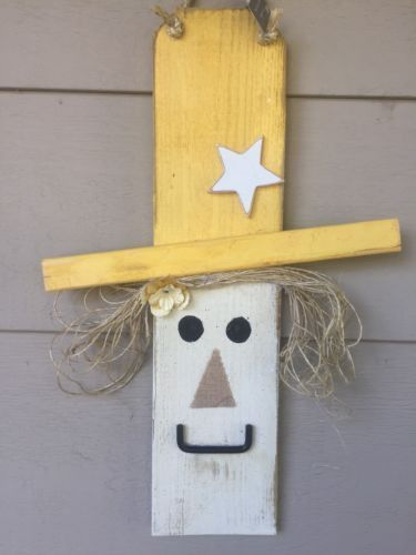 This Is A Handmade Scarecrow Made From A Privacy Fence Slat That Has