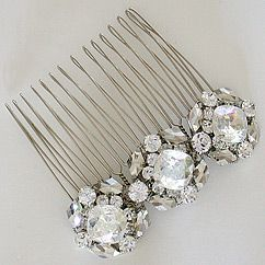 View our exquisite collection of bridal hair accessories & hair combs from the Erin Cole Bridal Collection.  Crystal & feather combs. Spectacular. Breathless. Find your style at Perfect Details.