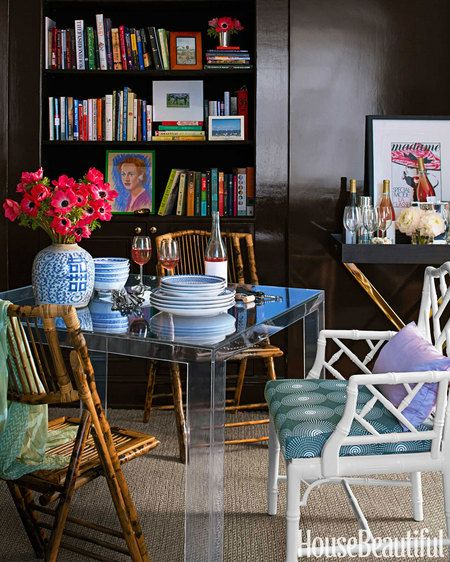 Dinner is served on an acrylic table by Kartell that seems to take up less space because it practically disappears. Bar table from West Elm.