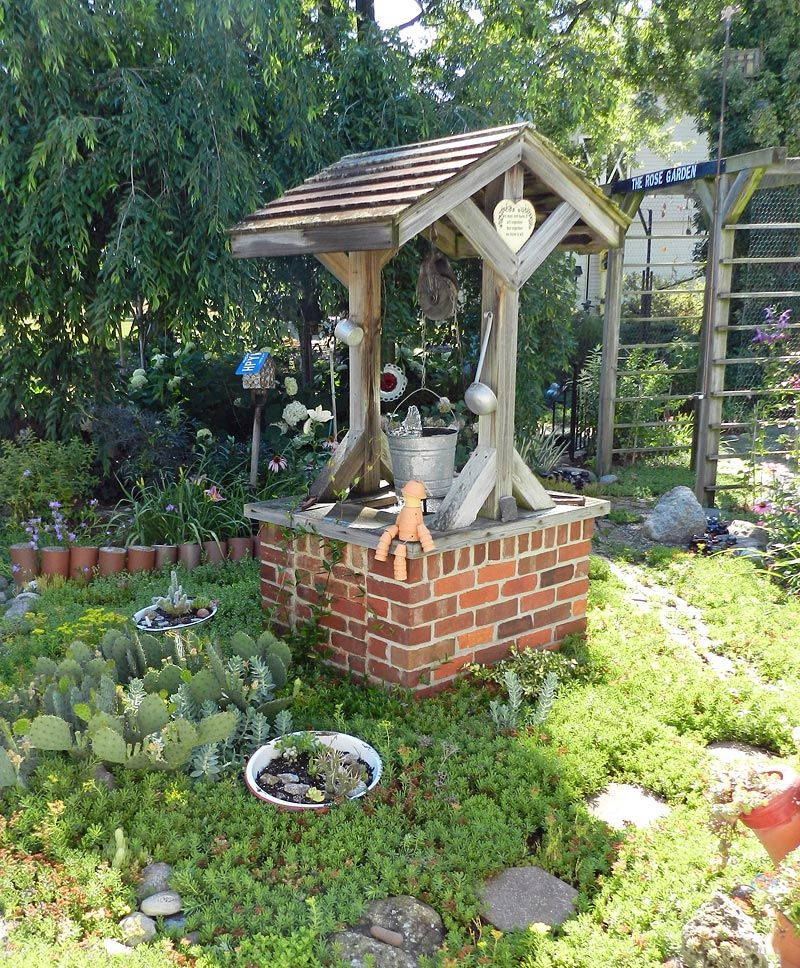 garden wishing well larry made the wishing well from an. Black Bedroom Furniture Sets. Home Design Ideas