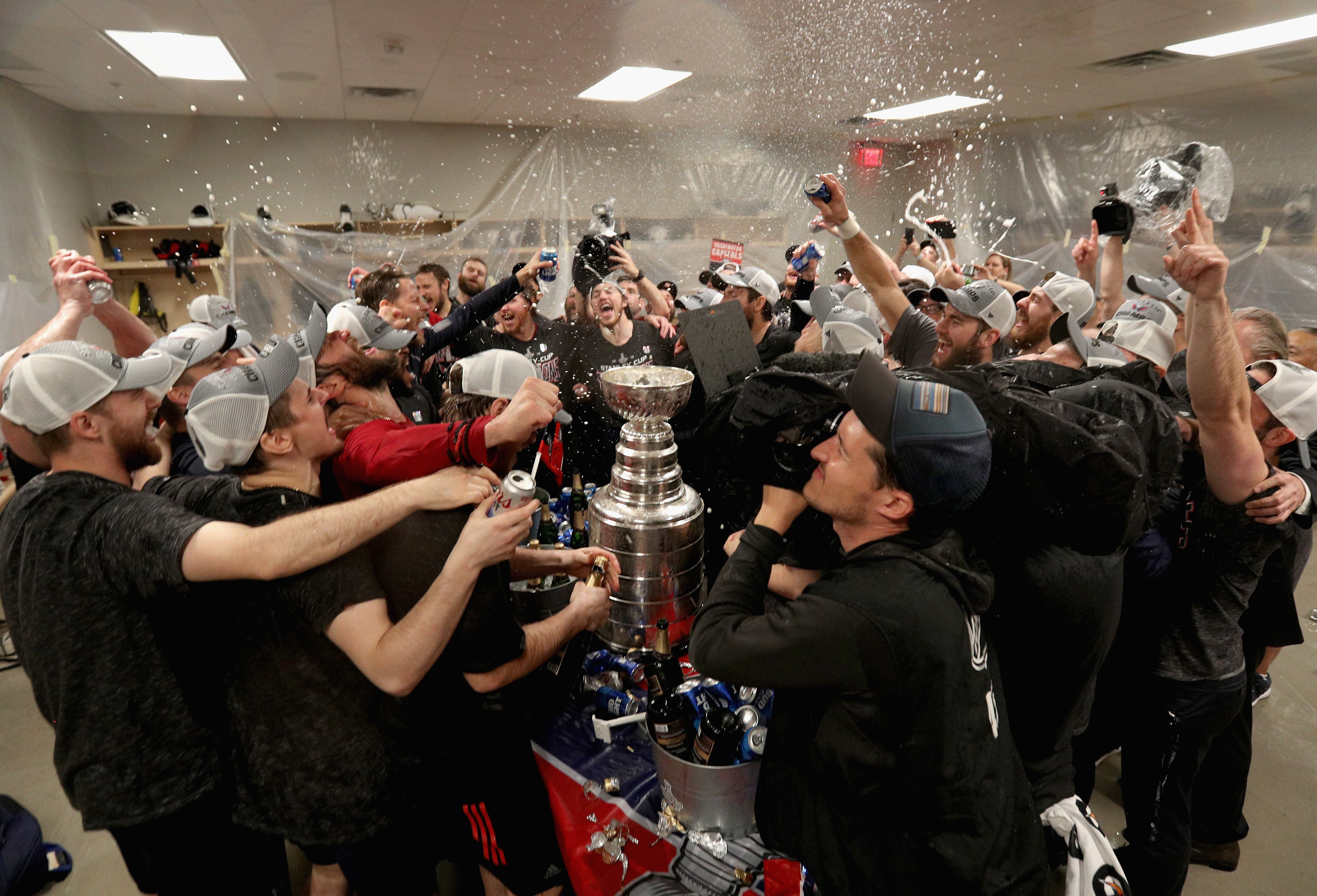 62807885800bad LAS VEGAS, NV - JUNE 07: The Washington Capitals celebrate winning the Stanley  Cup in the locker room after they defeated the Vegas Golden Knights 4-3 in  ...