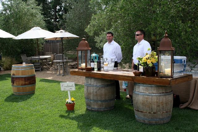 rustic bar with wine barrels @ outdoor wedding reception