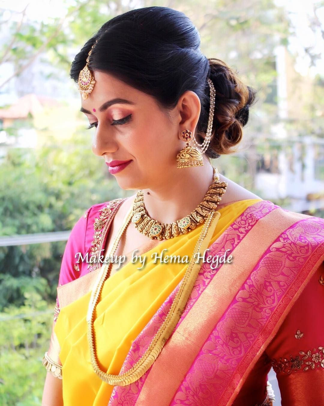 South Indian Wedding Indian Wear Pink And Yellow Silk Saree Traditional South Indian Wed Indian Wedding Hairstyles Indian Hairstyles Wedding Makeup Looks