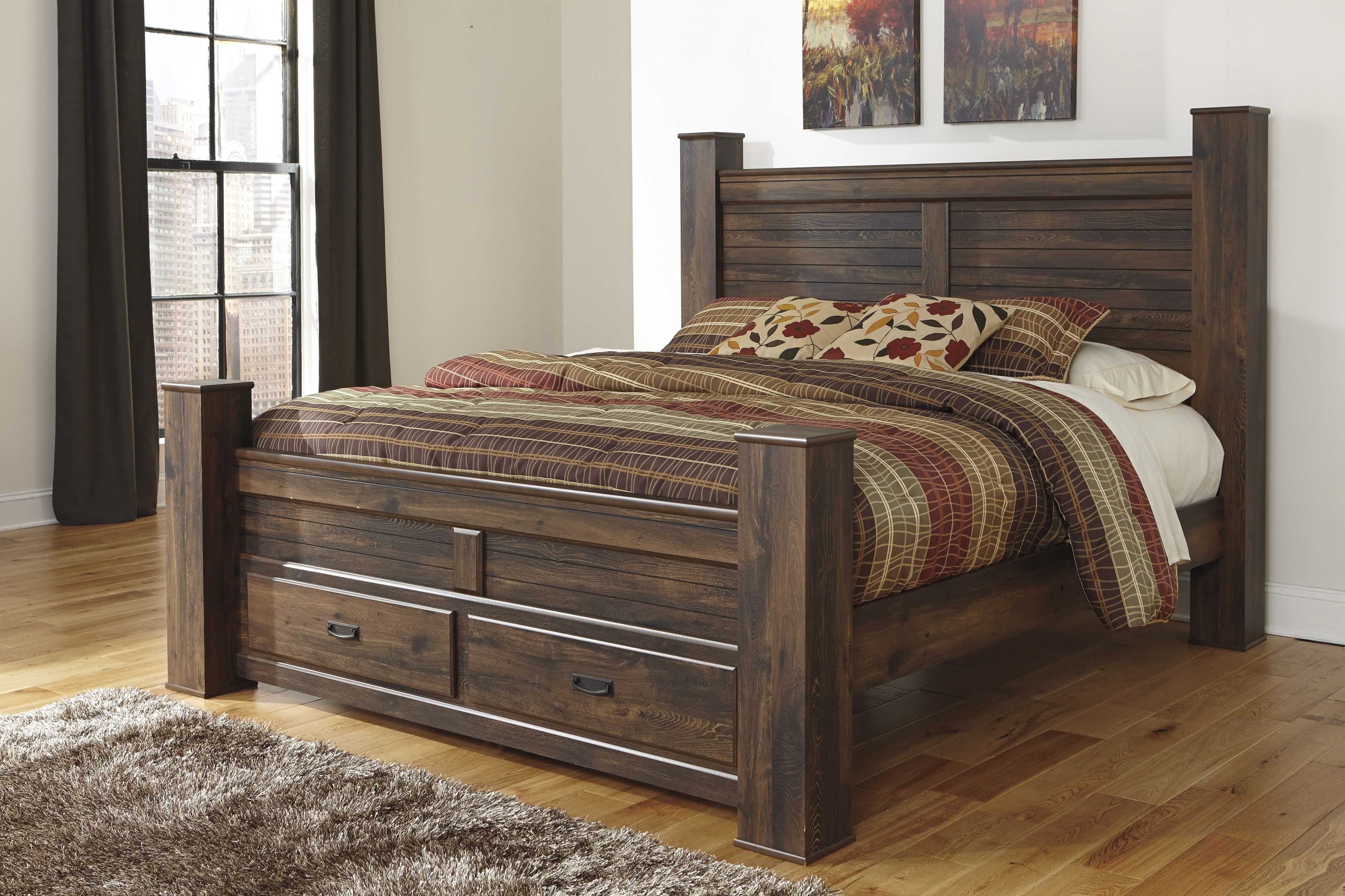 quinden dark brown king poster bed with footbed storage