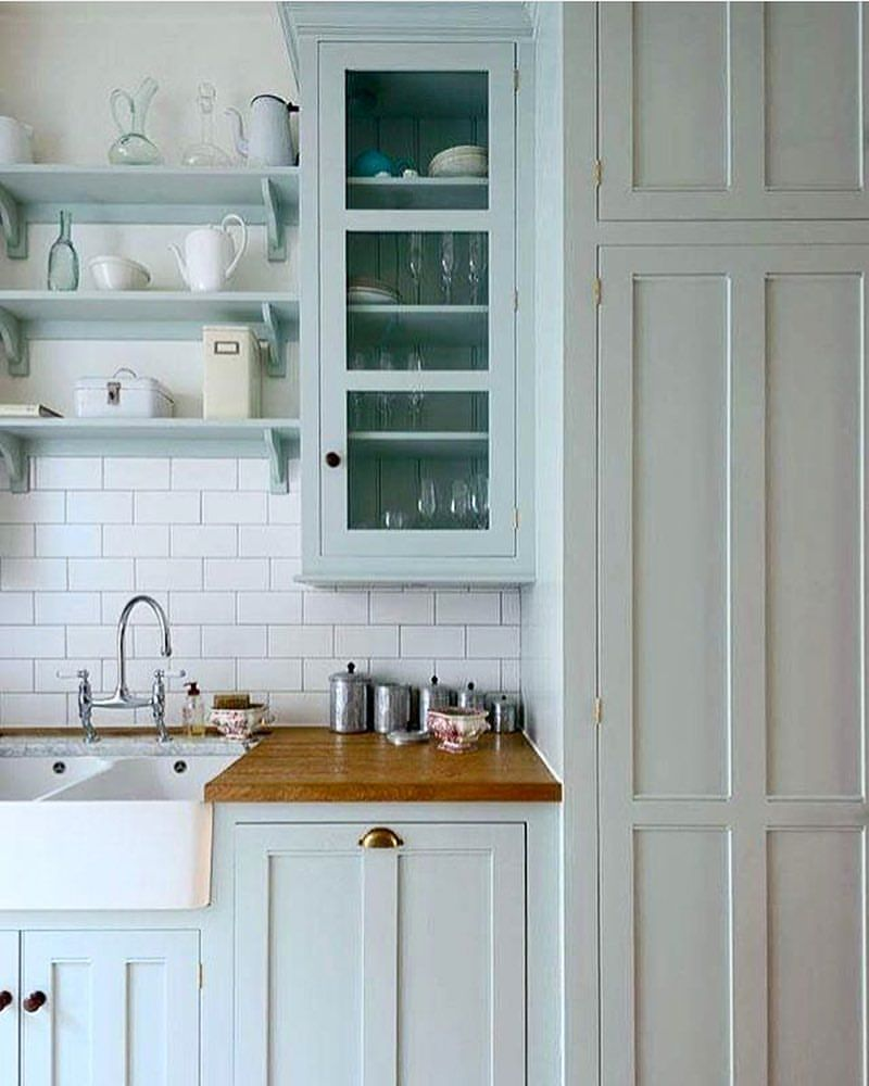 Love the light blue of these cabinets in this galley kitchen by ...