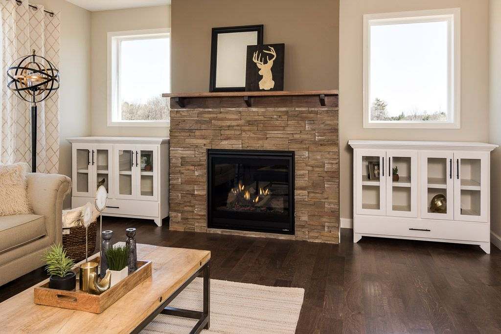 Stone Faced Gas Fireplace Built Ins And Hardwood Floors In Main Level Living Room Home Builders Fireplace Oak Laminate Flooring