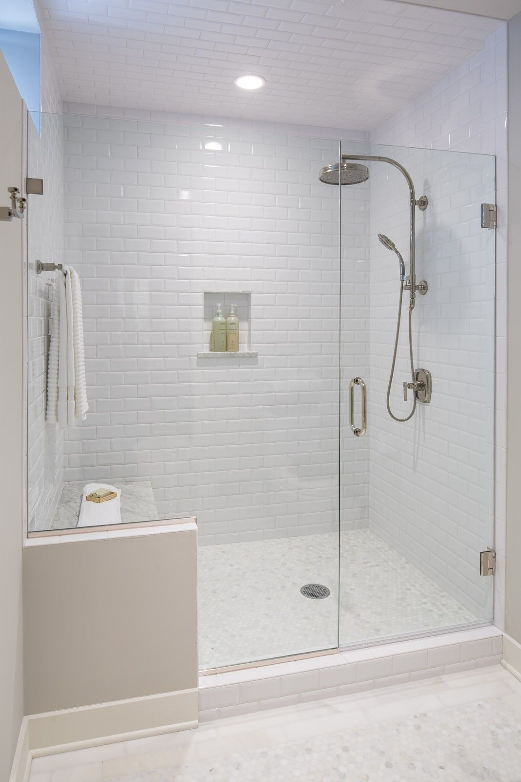 All white bathroom with subway tile even on the ceiling for All white bathrooms ideas