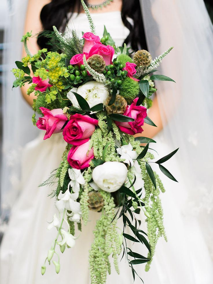 bold pops of colour in a cascading wedding bouquet