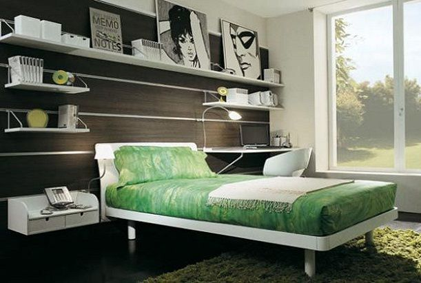 The dark wood paneling on the walls looks gorgeous with the green bed and white accents!