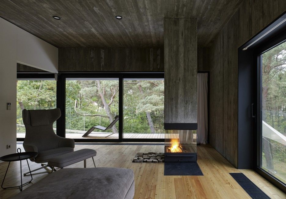 Excellent Tight House with Tight Wooden Material Construction: Fabulous Modern Fireplace Design At Living Room Use White Oak Flooring Decor With Fabric Egg Chair At Seaside House ~ CLAFFISICA Architecture Inspiration