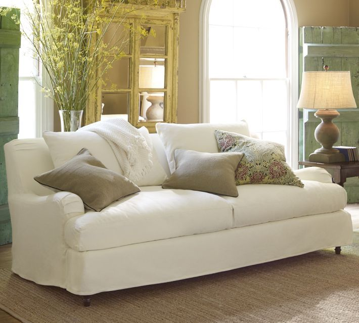 Classic white English arm sofa dressed down with a tailored slip