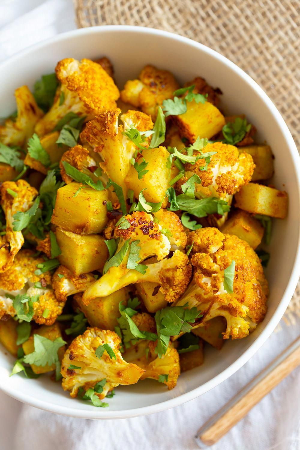 Baked Aloo Gobi - Indian Spiced Potato Cauliflower Bake. 10 Mins Active. Toss with spices, put it to bake, and done! No Standing around, no Mushy Cauliflower! Same Amazing Indian flavor and excellent texture. Tips to make the Best Aloo Gobi Subzi that bakes perfectly every time!