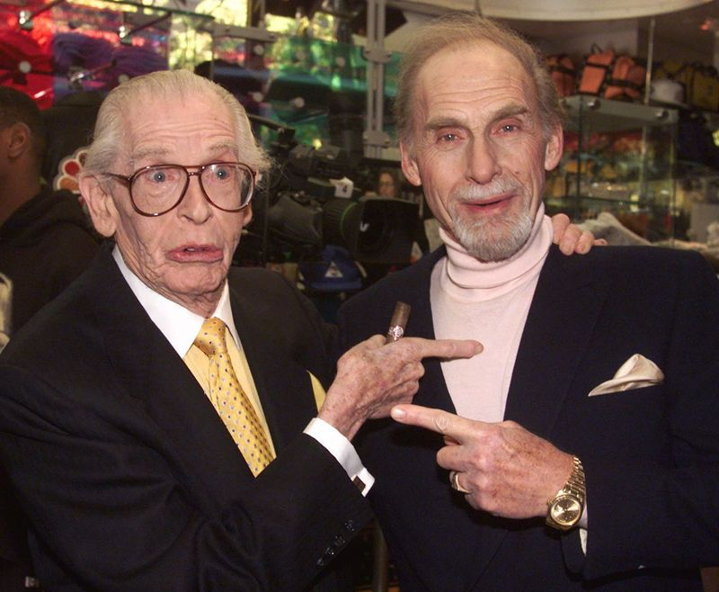 "Photo honoring Sid Caesar on Tributes.com. ""This Oct. 25, 1999 file photo shows Milton Berle, left, and Sid Caesar before being honored in as the first inductees into NBC's ""Walk of Fame"" in the network's Rockefeller Center store in New York. Caesar, whose sketches lit up 1950s television with zany humor, died Wednesday, Feb. 12, 2014. He was 91. """