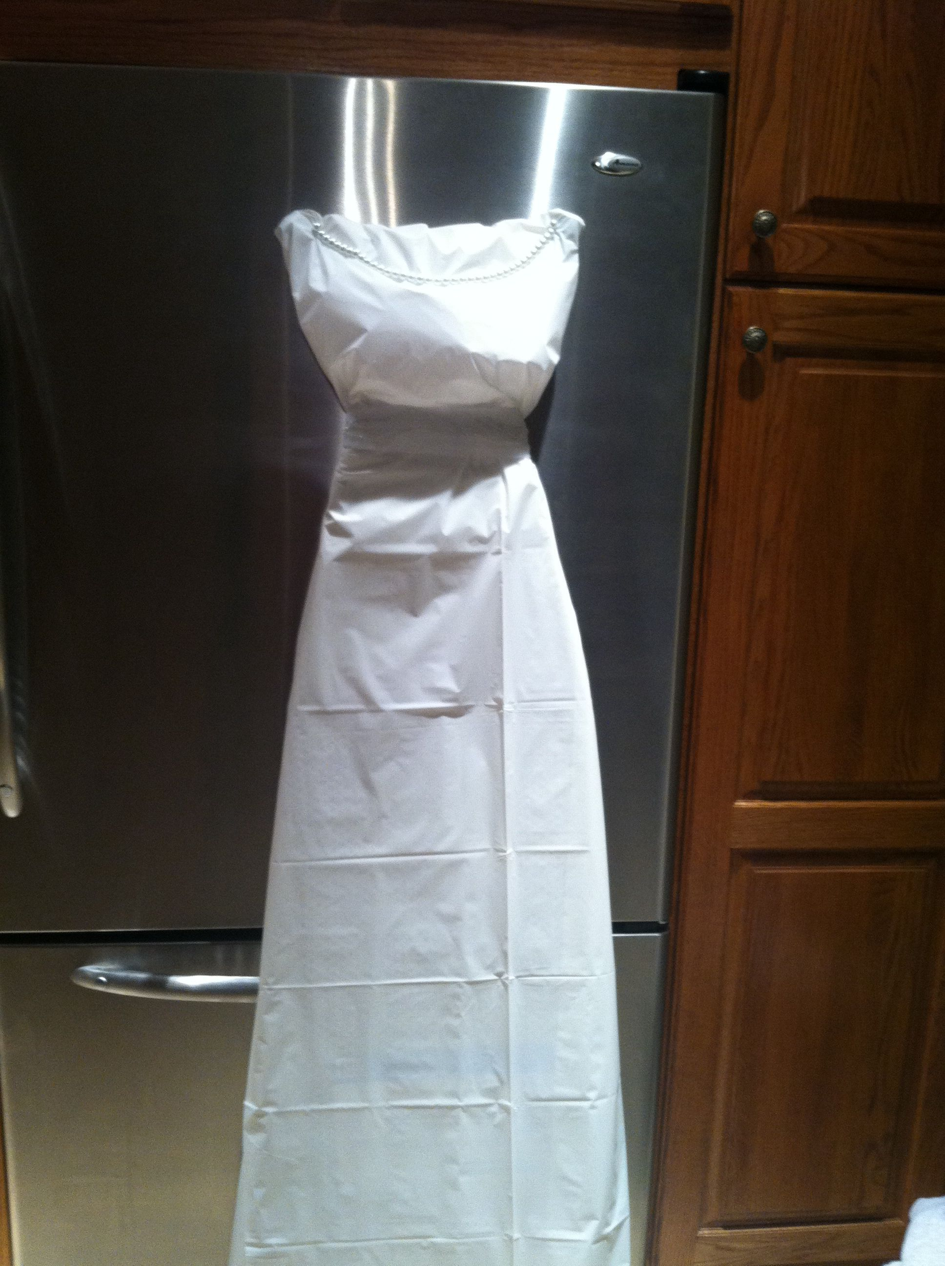 Jessica and I wrapped an ironing board for a bridal shower