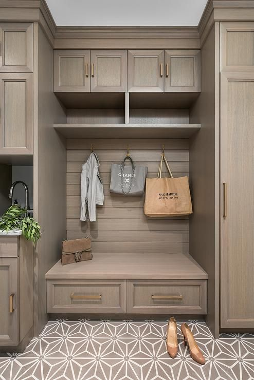 Floor To Ceiling Brown Mudroom Cabinets Accented With
