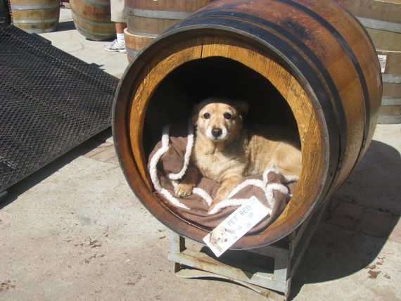 Rustic Pet House Made From A Wine Or Whiskey Barrel Sits On A