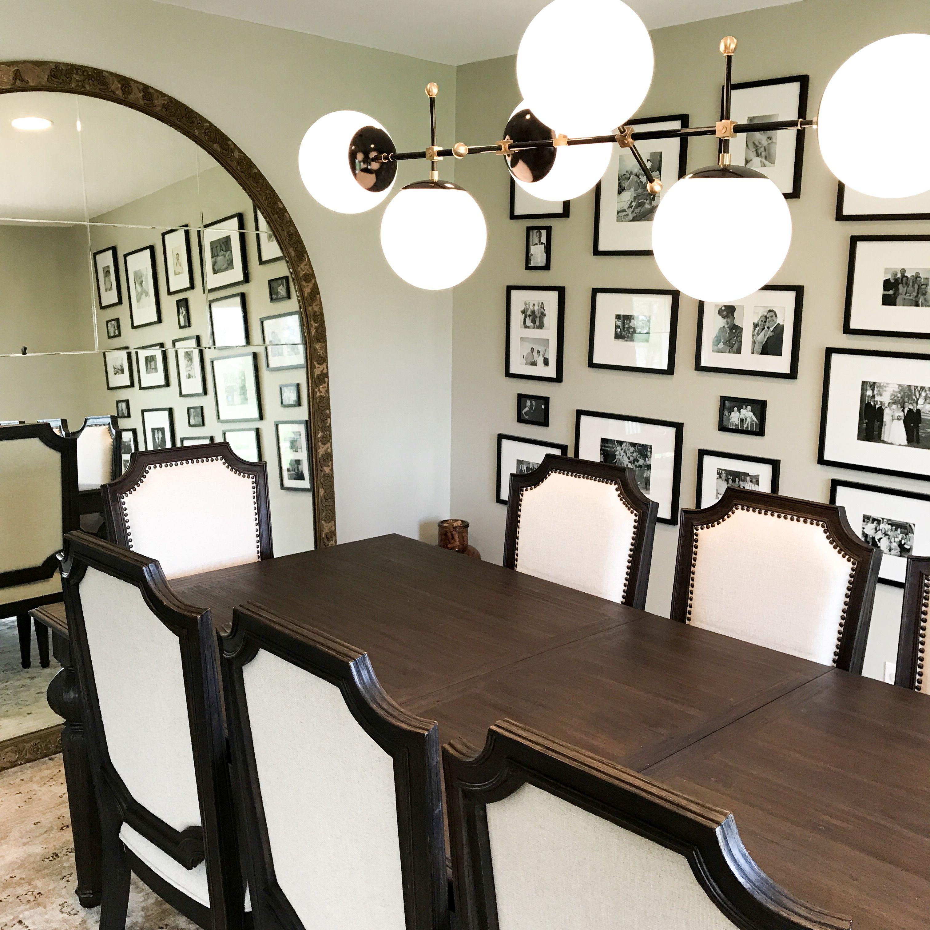 Black And Brass Cumula Globe Chandelier In Dining Room Wayzata MN