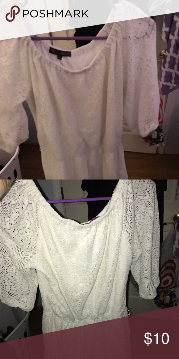 White Dress Have a half lace sleeve that is see through. Can be paired with a belt Dresses Midi