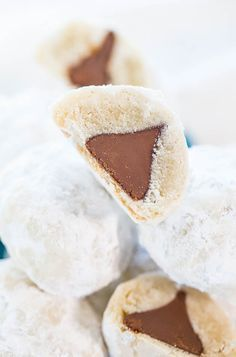 Chocolate Kiss Powder Puff Cookies - Easiest cookies ever with only 3 ingredients! The Kiss in the middle makes everyone smile!! So fun!! by @averie