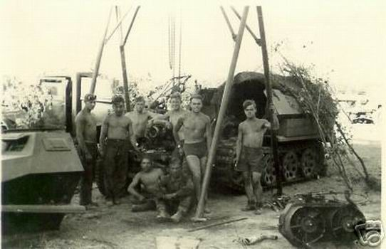 ENGINE REPAIRS ON A SDKFZ251. THE ENTIRE FRONTSUPERSTRUCTUREHAS BEEN REMOVED. THE COOLING FAN ASSY IS IN THE RIGHT FOREGROUND.