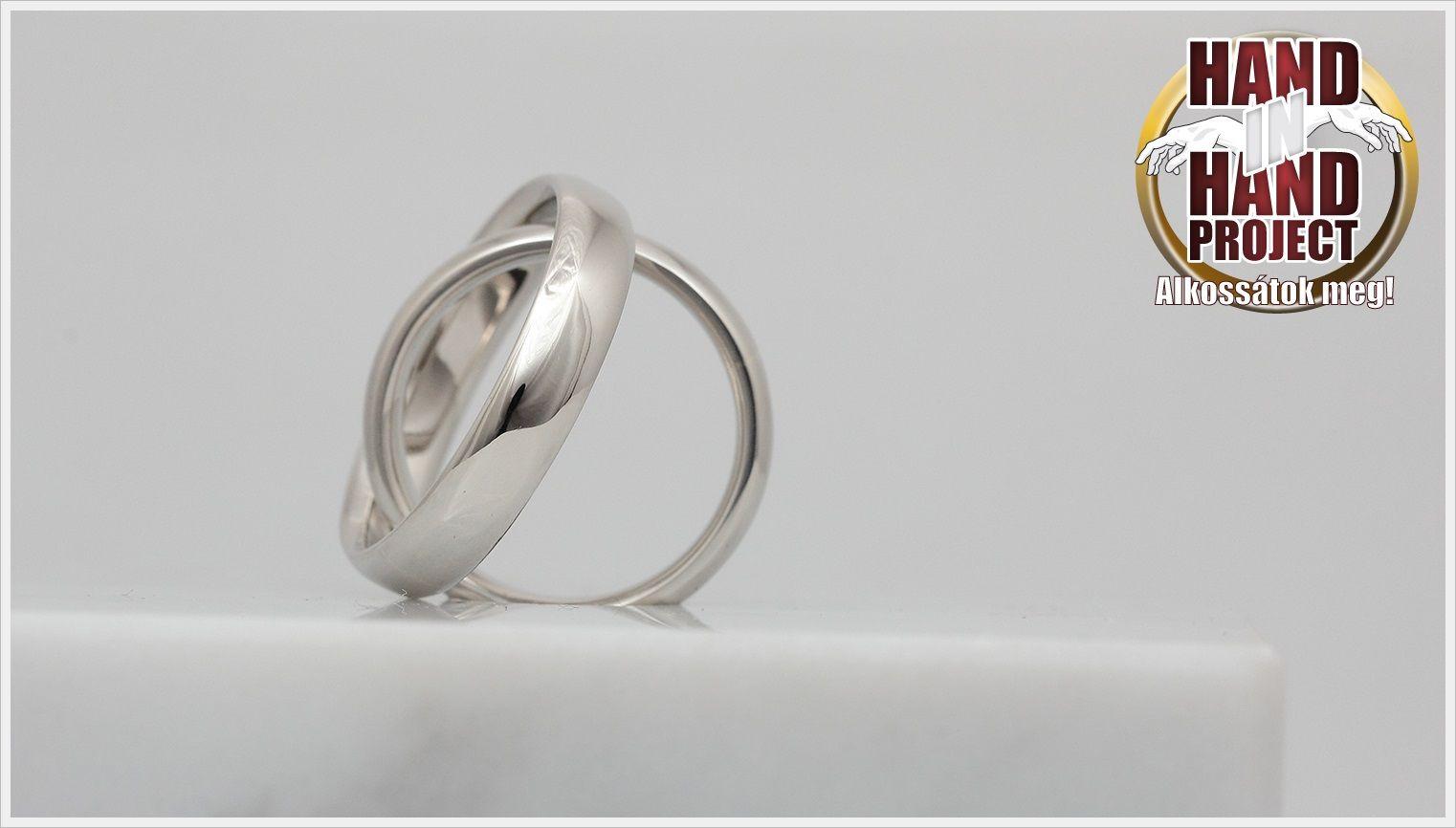 White gold wedding rings. (14-carat) Fehérarany. (Hand in Hand)