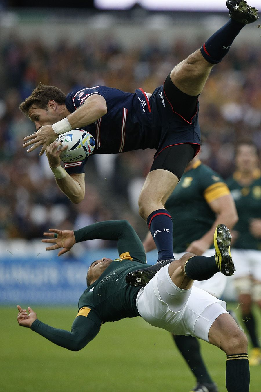 Bryan Habana of South Africa collides with Blaine Scully of the United States