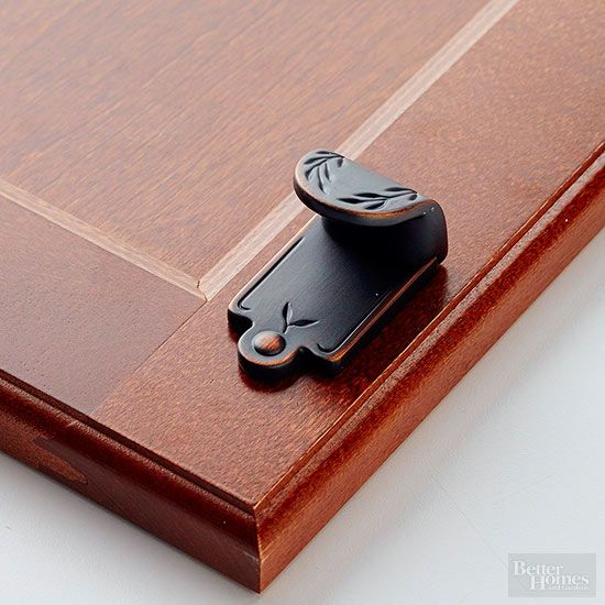 "Fresh Cutouts: Oil-rubbed bronze as seen in ""Cabinet Hardware for Every Kitchen Style"" on bhg.com #bhg #Amerock"