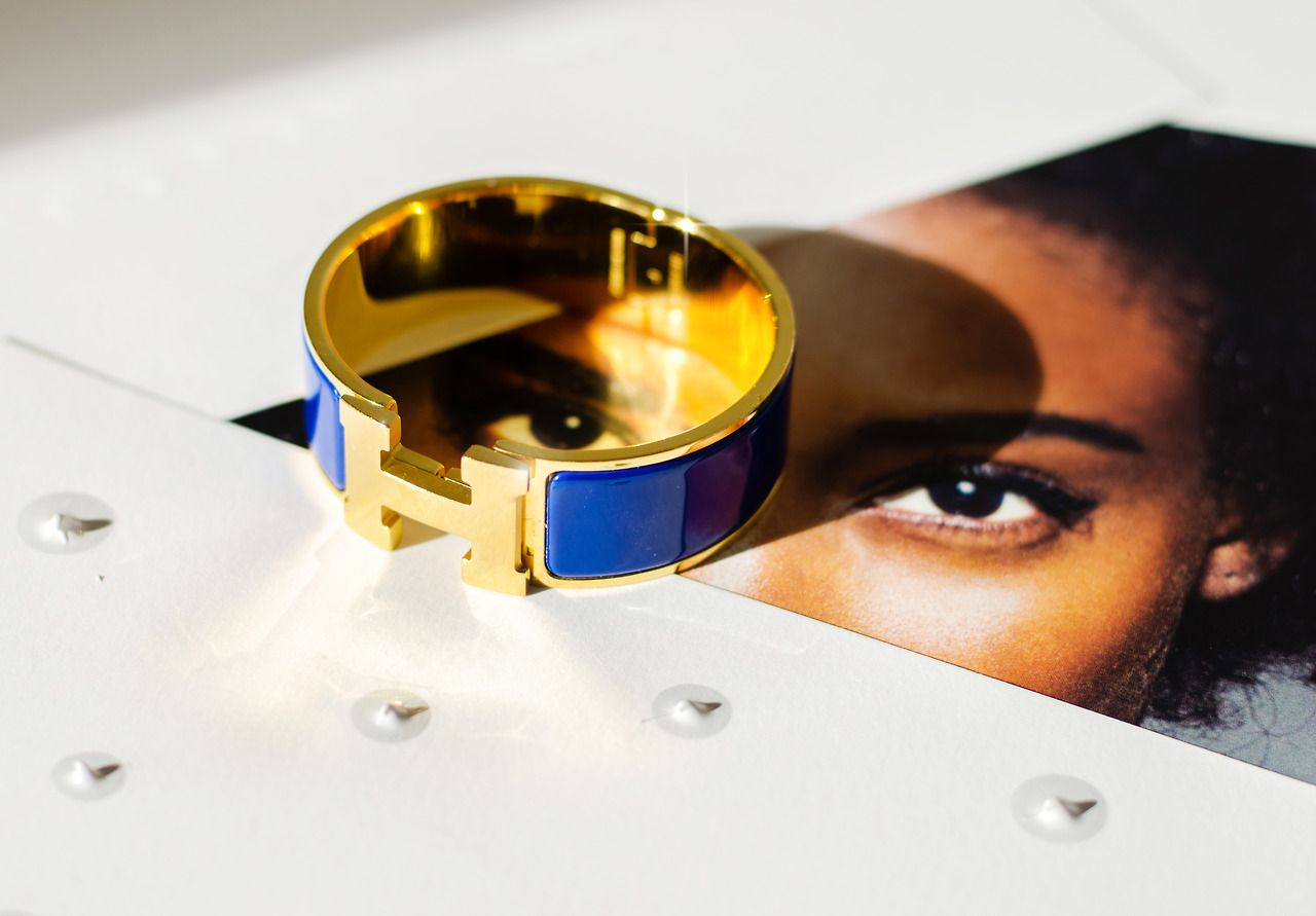 At C. Madeleine's we have a rich selection of one of a kinda vintage accessories like that gold/ blue Hermes bracelet. Online collection at www.cmadeleines.com  Shot By Agata Rek   Product photography.