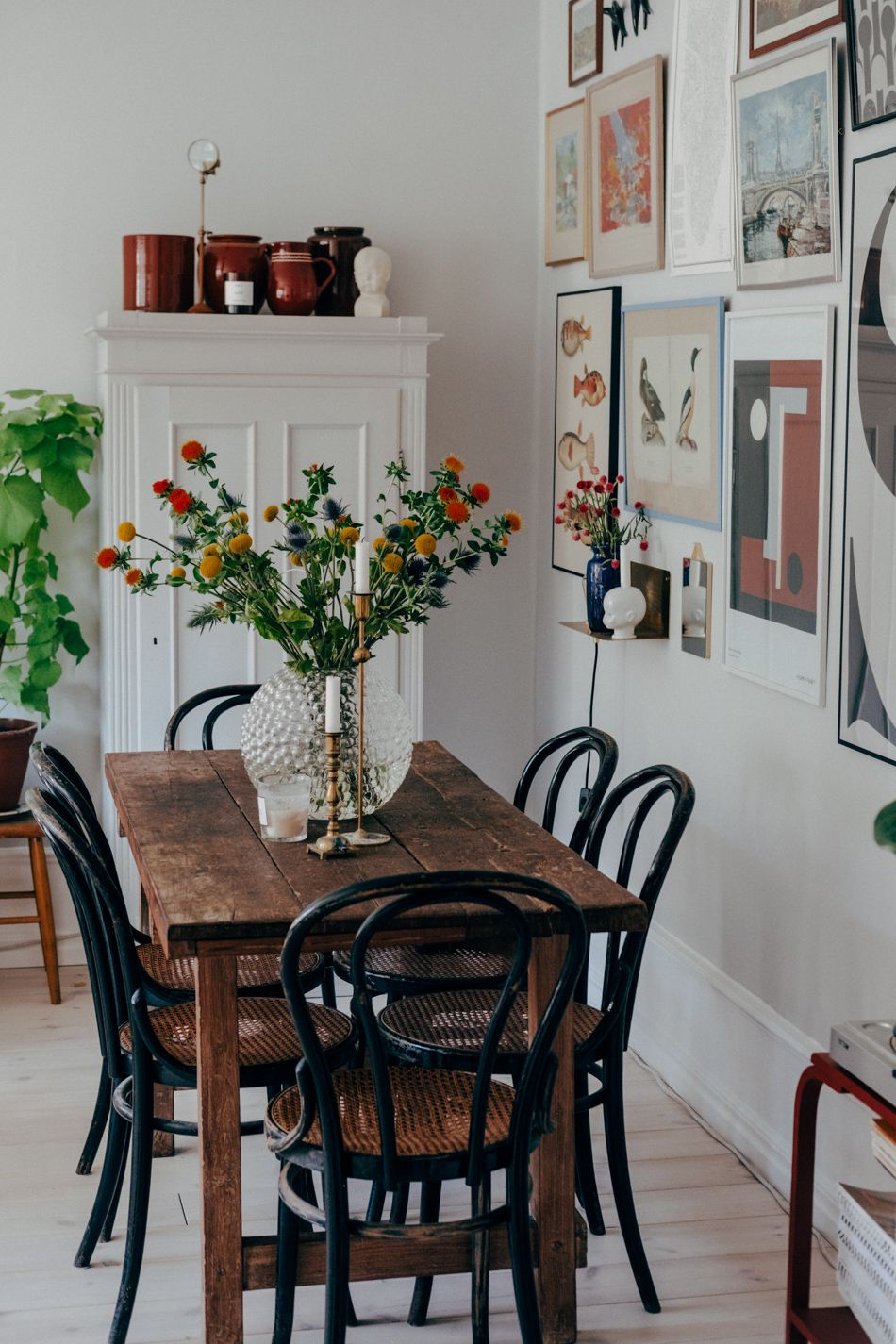 Simple farmhouse dining table, fresh flowers, picture collage ...