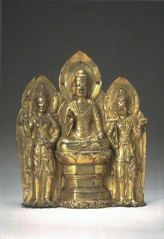 Embossed plaque with a buddha and two bodhisattvas  Place of Origin: China, Yunnan province  Date: 937-1253  Materials: Gilded bronze  Dimensions: H. 8 3/4 in x W. 7 1/2 in x D. 2 in, H. 21.9 cm x W. 19.1 cm x 5 cm